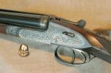 Горизонталка Holland & Holland Royal Paradox 20-го калибра с подъёмным целиком для стрельбы пулей и золотая пуля Paradox 20-го калибра, отлитая в фирменной пулелейке
